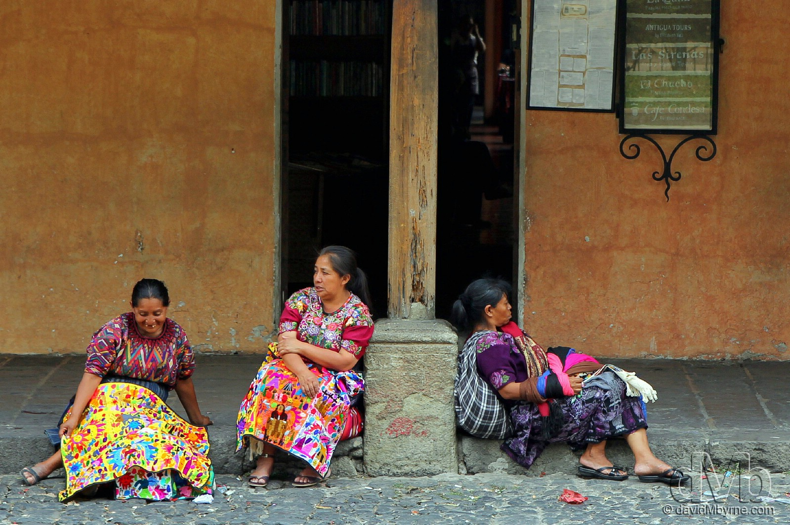 Three Mayan ladies taking a break from peddling their wares by the edge of Parque Central, Antigua, Guatemala. May 19th, 2013 (EOS 60D || Tamron 28-75 || 75mm, 1/250sec, f/4.5, iso100)