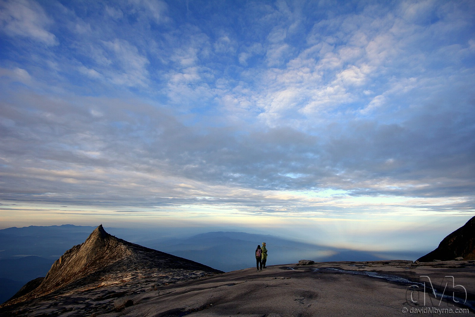Climbers on the granite expanse leading to the summit of Mount Kinabalu shortly after sunrise. Sabah, Malaysian Borneo. June 23rd, 2012 (EOS 60D || Sigma 10-20mm || 10mm, 1/125sec, f/8.0, iso100)